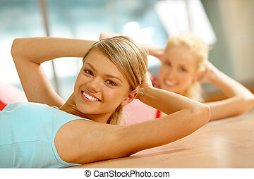 Fitness in gym - Photo of fit girl doing exercise on the...