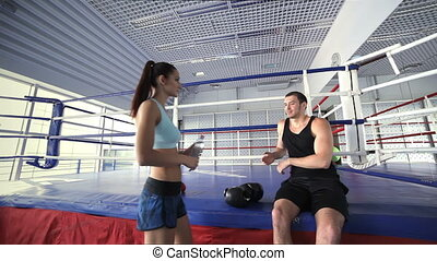 Fitness instructor and a young girl athlete