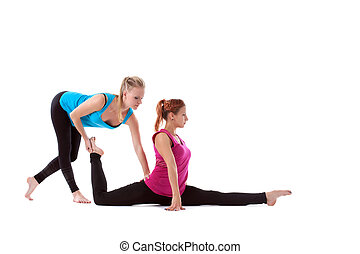 fitness instructor help young woman doing stretch