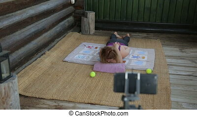 Fitness instructor making an online broadcast of her classes