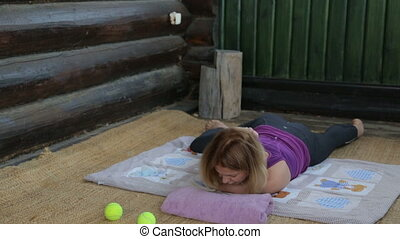 Fitness instructor making workout outdoor