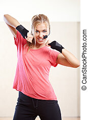 Fitness instructor - Smiling female fitness instructor in a...