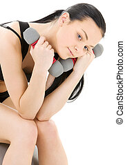 fitness instructor - tired fitness instructor with dumbbells...