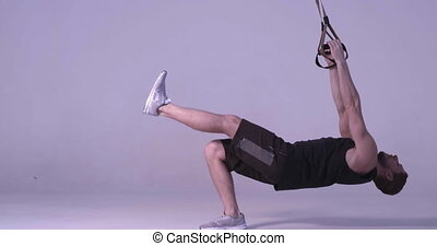 Fitness instructor training TRX exercises and leave after ...