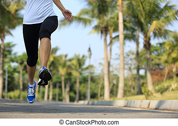 fitness jogger legs running at tropical park. woman fitness ...