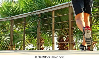 Fitness jogger running at tropical park fitness jogging...