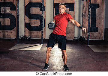 Fitness Kettlebells swing exercise man workout