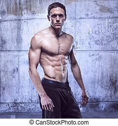 fitness male model in old garage