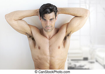 Fitness male - Sexy muscular man in bright modern interior