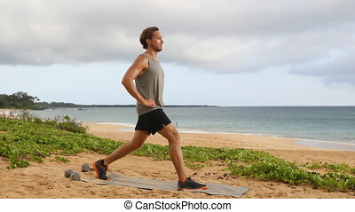 Fitness man doing Pulse Lunges exercise. Male fitness model doing Lunge Pulses workout while exercising on beach working out glutes, hamstrings and quadriceps. Right leg.