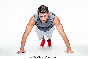 Fitness man doing push ups