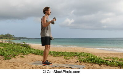 Fitness man doing Reverse Grip Biceps Curls - Dumbbell Bicep Curl exercise. Fit sport fitness model showing dumbbell weight lifting workout. REAL TIME.
