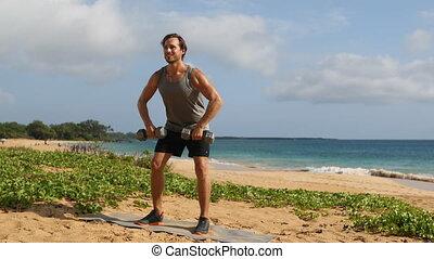 Fitness man exercising doing Standing Dumbbell Upright Row ...