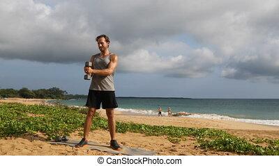 Fitness man exercising dumbbells workout doing Standing ...