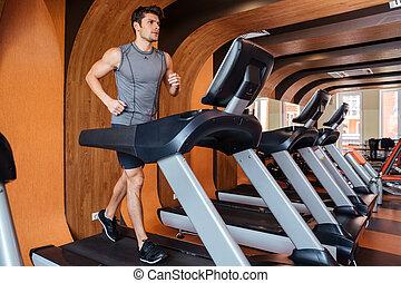 fitness, man, het uitwerken, en, rennende , op, tredmolen,...