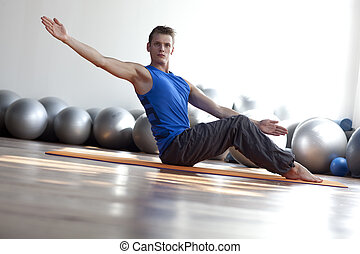 fitness - man practicing pilates - Fusion of mind and body -...