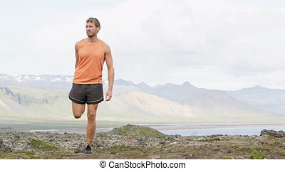 Fitness man stretching thigh exercise outdoors after workout exercising in amazing nature landscape. Fit male athlete cross-training outside. Video from Iceland. RED EPIC, REAL TIME.