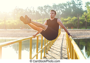 Fitness man workout. Runner warming up and exercising.