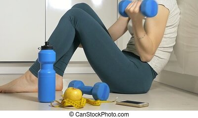 Fitness mature woman working out with dumbbells. Healthy lifestyle