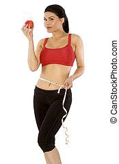fitness model - pretty brunette wearing sport outfit on...