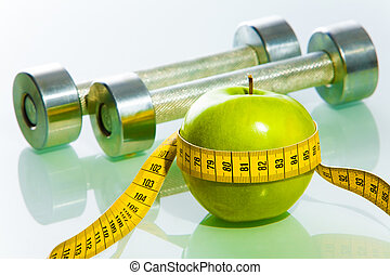 Fitness objects - Close-up of green apple tied with...