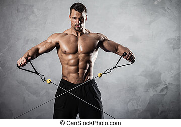 Fitness on crossover - Brutal athletic man pumping up ...