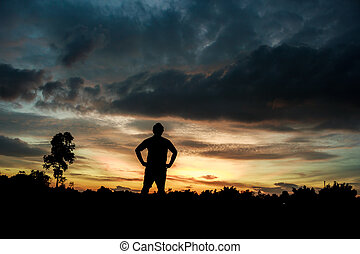 Fitness on silhouette sunrise The boy  workout wellness concept.