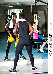 Fitness people working out with equipments - Mirror...