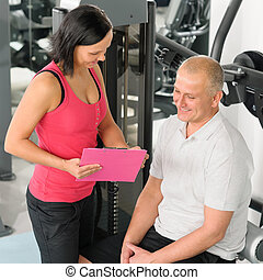 Fitness personal plan active man with trainer