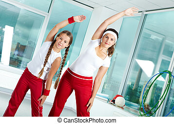 Fitness - Portrait of healthy female and her daughter ...