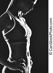 Fitness - Portrait of slim female in activewear standing in ...