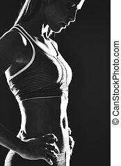 Fitness - Portrait of slim female in activewear standing in ...