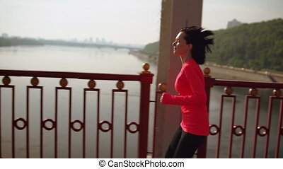 fitness routine girl runs in city - healthy active...