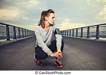 Fitness Runner on the Bridge Resting