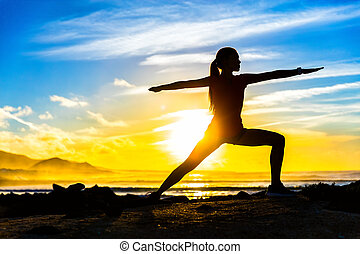 Fitness silhouette practicing warrior II yoga pose