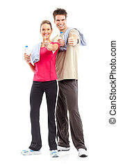 Fitness. Smiling young strong man and woman. Isolated over...