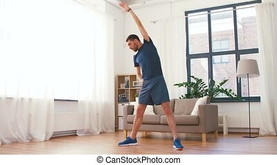 man exercising and leaning at home
