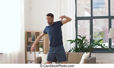 man exercising and leaning at home - fitness, sport and...