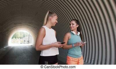 women or female friends with smartphones - fitness, sport...