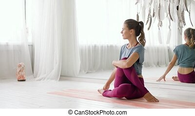 woman doing yoga exercise at studio - fitness, sport and...