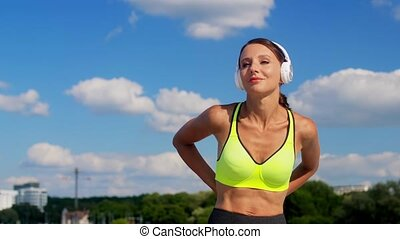 woman with headphones and smartphone running - fitness, ...