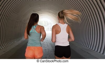young women or female friends running outdoors - fitness,...