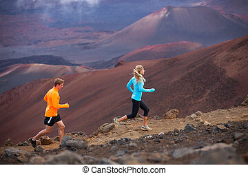 Fitness sport couple running jogging outside on trail -...