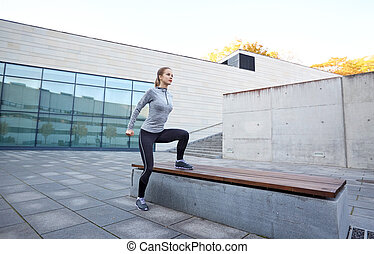 woman exercising on bench outdoors - fitness, sport, people...
