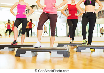 close up of women legs steping on step platform - fitness, ...