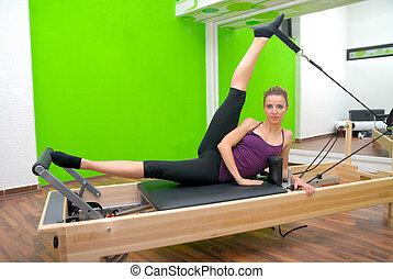 fitness - pretty girl exercising in fitness studio