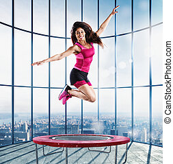 Fitness teacher jump at the modern gym - Fitness teacher...