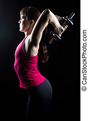 Fitness trainer doing exercise with weights