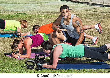 Fitness Trainer Helping Students