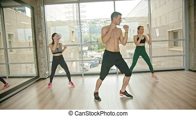 Fitness training in the studio - two young women training...